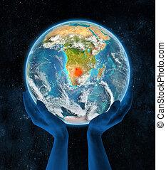 Botswana on planet Earth in hands