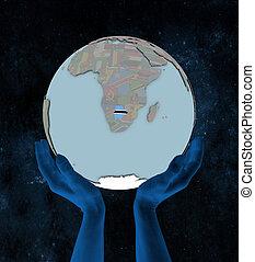 Botswana on political globe in hands
