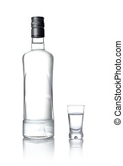 Bottle and glass of vodka standing isolated on white - Close...