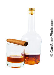 Bottle and glass of whiskey with cigar