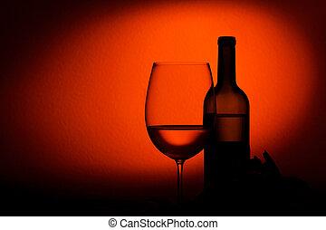 Bottle and glass of wine - studio shot