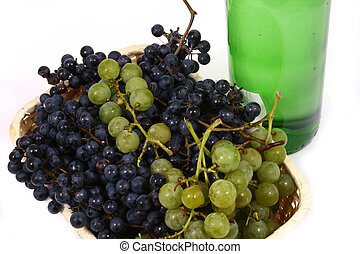 bottle and grapes isolated on white
