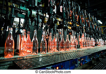 Bottle factory, row of glass bottles