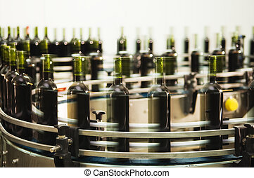 Turntable of a bottle filling line at a modern winery Inspectors note - creative use of motion blur
