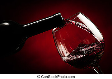 Bottle filling the glass of wine - splash of delicious ...