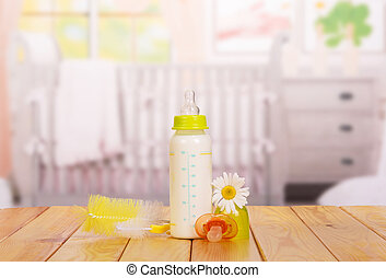 bottle of baby milk on the table in nursery