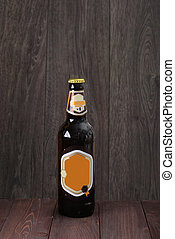 bottle of beer on a wooden background