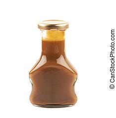 Bottle of caramel sauce isolated