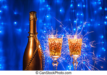 Bottle of champagne and glasses with in New year and xmas on blue background