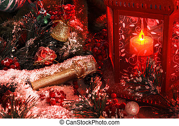 bottle of champagne is covered with snow in the light of a red lantern on the background of New Year's decorations