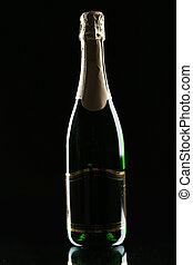 Bottle of champagne on a black background