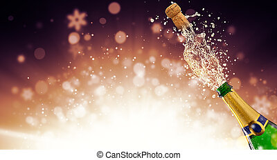Bottle of champagne over fireworks background - Splashing...
