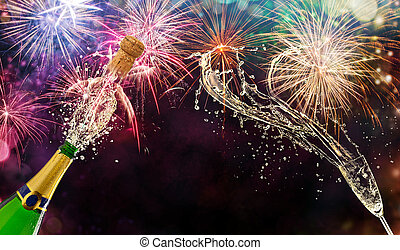 Bottle of champagne with glass over fireworks background. Celebration concept, free space for text