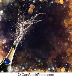Bottle of champagne with glasses over fireworks background