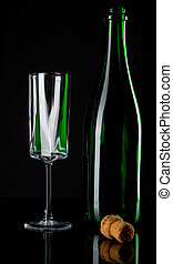 Bottle of champagne with wineglass