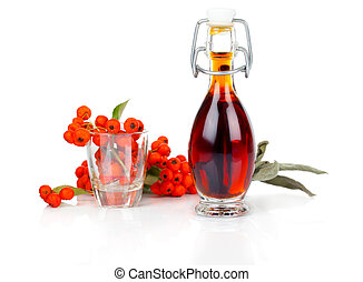 bottle of drink, mixture with ashberry on white background.
