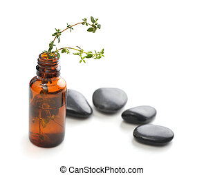 Bottle of essential oil with herbs thyme