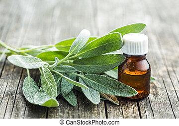Bottle of essential sage oil. - Bottle of essential sage oil...