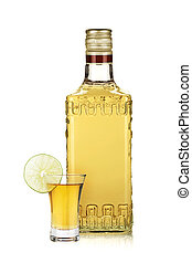 Bottle of gold tequila and shot with lime slice. Isolated on...