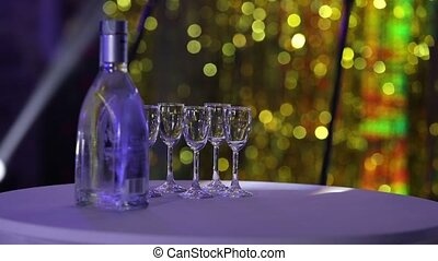 Bottle of liquor on the table, a bottle of vodka and wine...