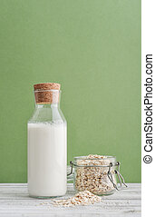 Bottle of oat milk with oat flakes