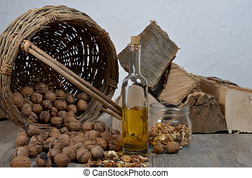 bottle of oil with nuts,
