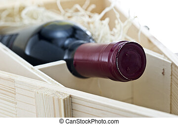 Bottle of old red wine in gift wooden box
