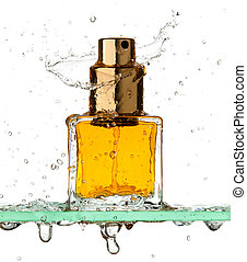 Small rectangular bottle of perfume all in a spray of water on a white background