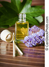 bottle of perfume oil in the environment of the spa