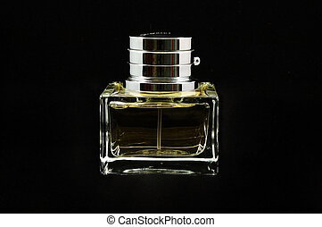Bottle of perfume over black background - An isolated ...
