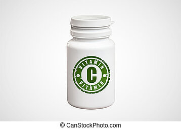Bottle of pills with vitamin C on white background