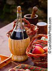 bottle of red wine and fruit