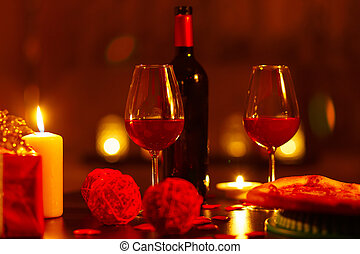 Bottle of red wine and glasses. - Bottle of red wine and...