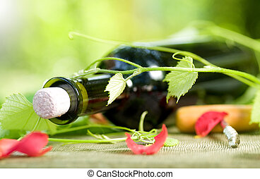 Bottle Of Red Wine And Grape Leaves