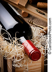 Bottle of red wine in gift wooden box