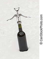 Bottle of red wine in the snow