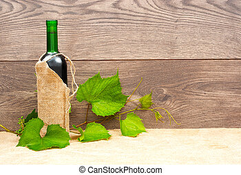 bottle of red wine on a wooden background