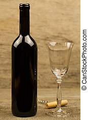 bottle of red wine on wooden background