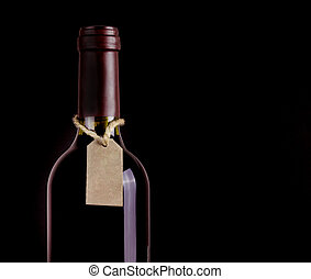 Bottle of red wine with tag