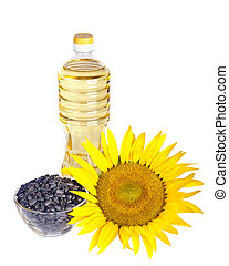 Bottle of sunflower oil with flower and seed isolated on white background