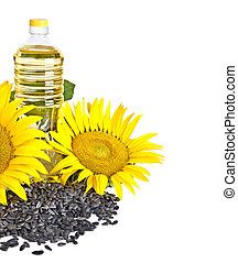 Bottle of sunflower oil with flower and seed isolated on white