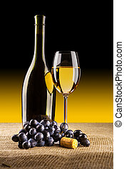 bottle of vine with glass and grape