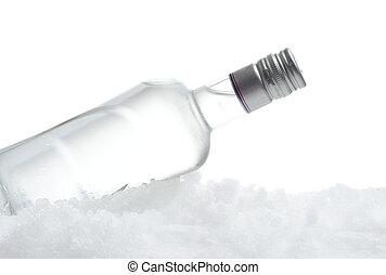 Bottle of vodka lying on ice on white background - Close-up ...