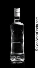 Bottle of vodka standing isolated on black background