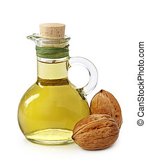 Bottle of walnut oil on white background