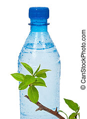 Bottle of water with green apple branch
