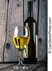 bottle of white wine and wineglass