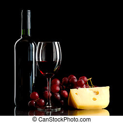 Bottle of wine, a bunch of red grapes and a piece of cheese...