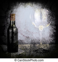 Bottle of wine and big glass on dark background with texture