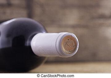 bottle of wine on wooden background